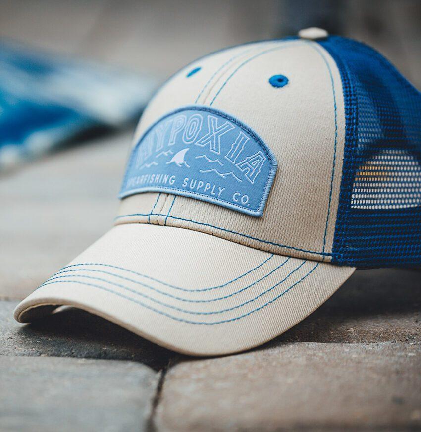 HYPOXIA Fin Badge Cream Dream Freediving Spearfishing Trucker Hat Outside Bricks